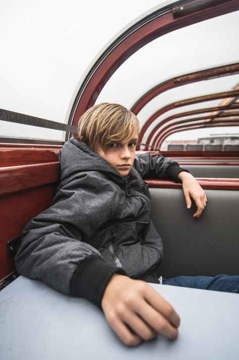 boy wearing hooded jacket